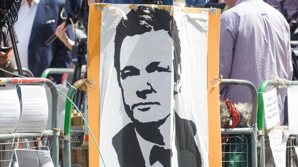 A banner displaying Julian Assange&#x27;s face outside Ecuador&#x27;s embassy in London