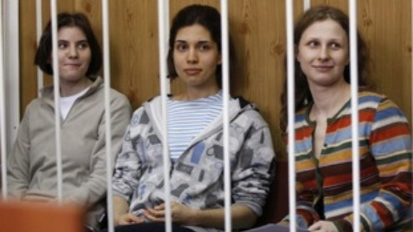 Members of female punk band Pussy Riot sit behind bars in Moscow.