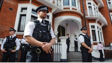 Police officers outside the Embassy of Ecuador in Knightsbridge, central London