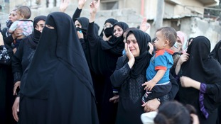 Relatives react at the funeral of a Palestinian youth shot in clashes with Israeli security forces.