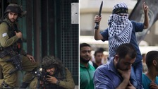 Palestinians clash with Israeli border police during clashes at a checkpoint