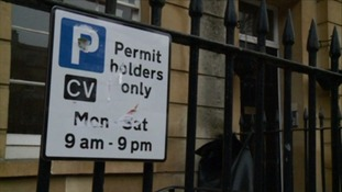 Defaced parking sign in Bristol