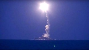 A Russian navy ship launches a missile towards Syria.