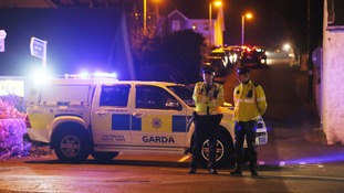 Police officers guard the scene in County Louth.