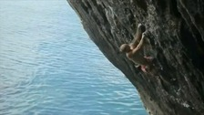 Neil Gresham scales the cliff face in Pembrokeshire.