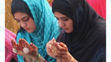 Female devotees take part in the Congregational prayers of Eid al-Adha