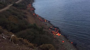 The coastline along Lesbos has turned bright orange with the life jackets of the refugees.