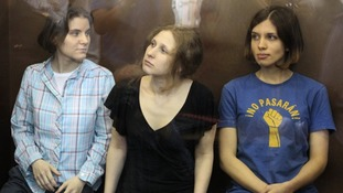 Pussy Riot members listen to the judge's guilty verdict