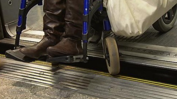 Tamisha's wheelchair gets stuck between the platform and the tube