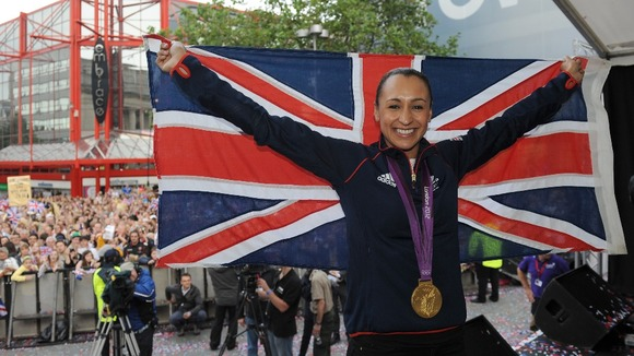 Great Britain's Jessica Ennis celebrates with her gold medal during her Olympic homecoming in Sheffield city centre
