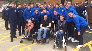 Football stars give £10,000 to charity