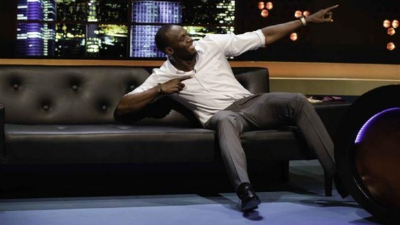 Usain Bolt does his trademark celebration pose