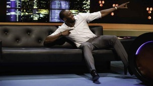 Usain Bolt does his trademark celebration pose