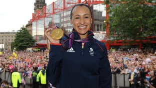 Jessica Ennis celebrates with her gold medal during her Olympic homecoming in Sheffield city centre.