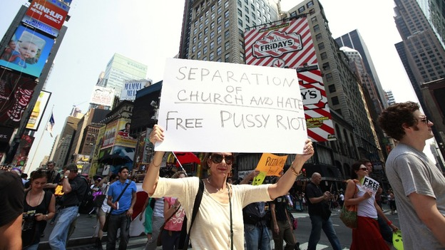 Protesters hold signs and march through Times Square while demonstrating in solidarity with the Russian punk band Pussy Riot in New York