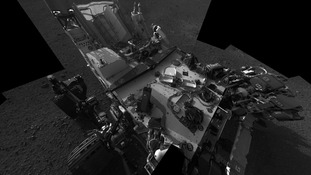 An image of the Curiosity rover's deck taken from the rover's Navigation camera.