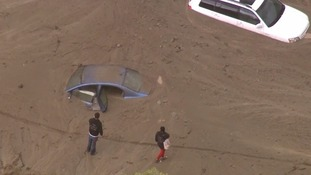 Cars swamped as California hit by floods and mudslides