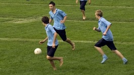 Students play football on a field