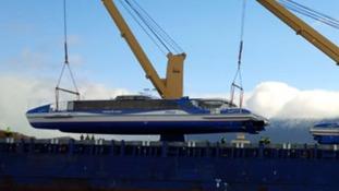 Catamarans loaded onto a vessel in Hobart, Tasmania