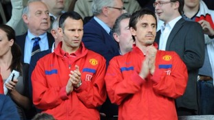 Manchester United's Ryan Giggs (left) with team mate Gary Neville, in the stands.