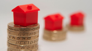 Model houses on pound coins