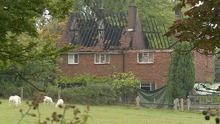 One person was killed as fire ripped through two homes in Hertfordshire.