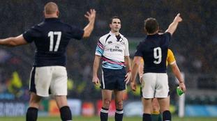 Scottish players appeal to referee Craig Joubert.