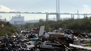 n illegal fly tip site alongside the Thames estuary at Purfleet in Essex.