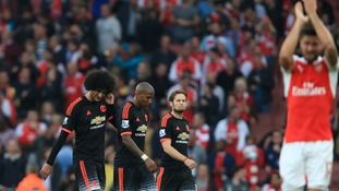 Manchester United's players walk off dejected at the end of the match