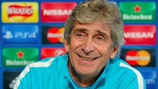 Pellegrini: Midfielder Toure is happy at Man City