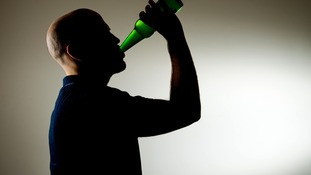 File photo of a man drinking a beer