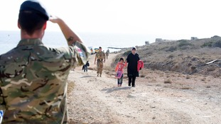 RAF servicemen help with the arrivals.
