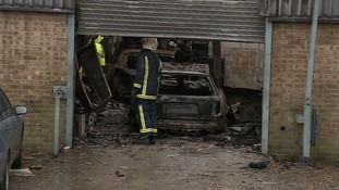 The blaze at Corby Car Centre was tackled by more than 30 firefighters.