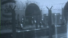 CCTV of migrants storming the tunnel