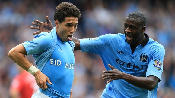 Manchester City's Samir Nasri (left) with team-mate Yaya Toure.