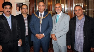 Cllr Ferman Ali, Deputy Mayor of Calderdale, and trainer Nadeem Mir with taxi drivers who have completed their training.
