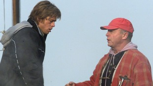 Brad Pitt seen talking to Tony Scott during the film of 'Spy Game' in Budapest