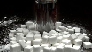 Sugar cubes and drink