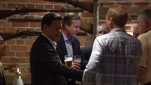 President Xi shares a joke with a fellow drinker
