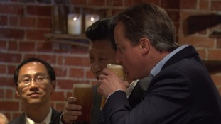 Time for a swift pint? David Cameron takes China's President Xi to his local pub