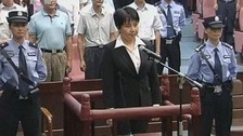 Gu Kailai seen as she receives a suspended death sentence for Neil Heywood's murder
