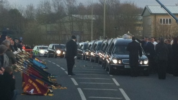 The cortege carrying the bodies of six soldiers killed in Afghanistan arrives in Carterton