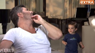 Simon Cowell's young son Eric crashes dad's interview