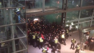 Two arrested after pro-refugee protesters clash with police at St Pancras