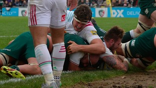 Leicester Tigers' Laurence Pearce dives in to score the winning try