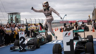 Hamilton leaps from his car after sealing the title in Texas.
