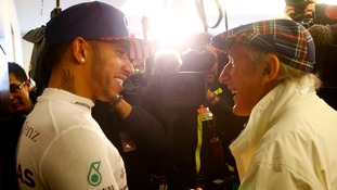 Sir Jackie Stewart congratulates Lewis Hamilton after Sunday's race.