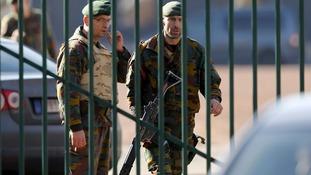 Shots fired as masked gunman rams car at military barracks