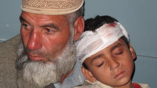 Father and son post-quake in Pakistan