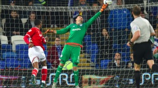 Cardiff City goalkeeper David Marshall tips the ball over the bar after a shot from Bristol City's Jonathan Kodjia (left)